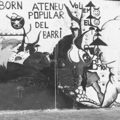 Pintada reivindicativa en un mur del barri
